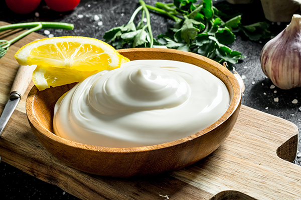 Homemade mayo in wooden bowl