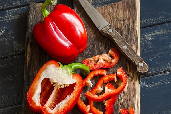 Fresh red sweet pepper on a wooden board