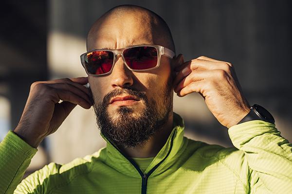 Man wearing polarized sunglasses outside