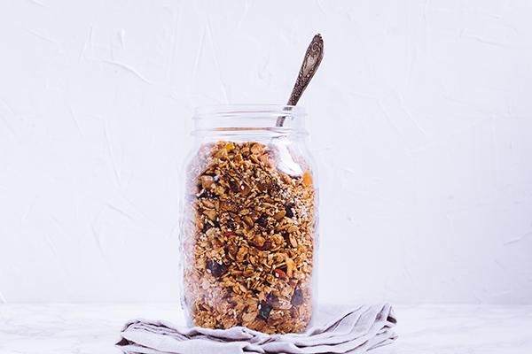 Delicious homemade granola in glass jar snack.