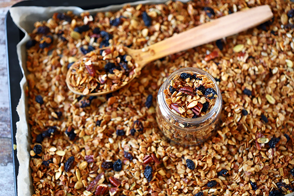 Homemade granola in a jar and on a baking pan.