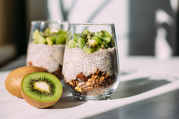 Chia seed pudding with kiwi and granola in glass