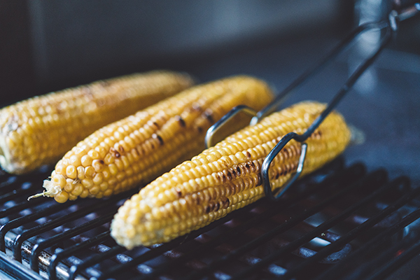 Grilling the corn on a barbecue grill.