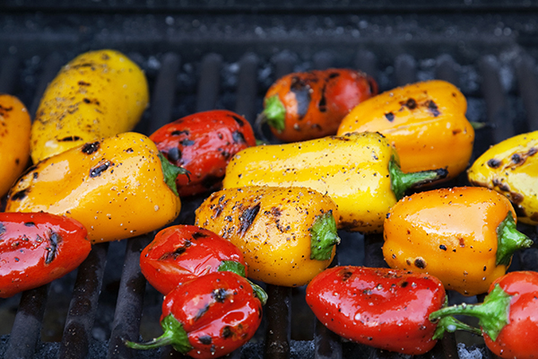Colorful little roasted peppers on the grill.