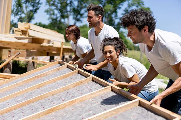 Volunteers helping build a house