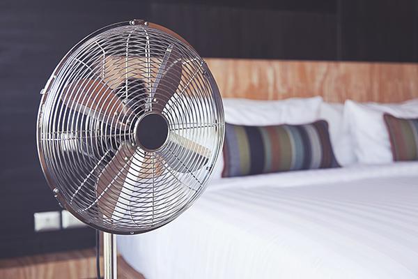 Electric fan in a bedroom