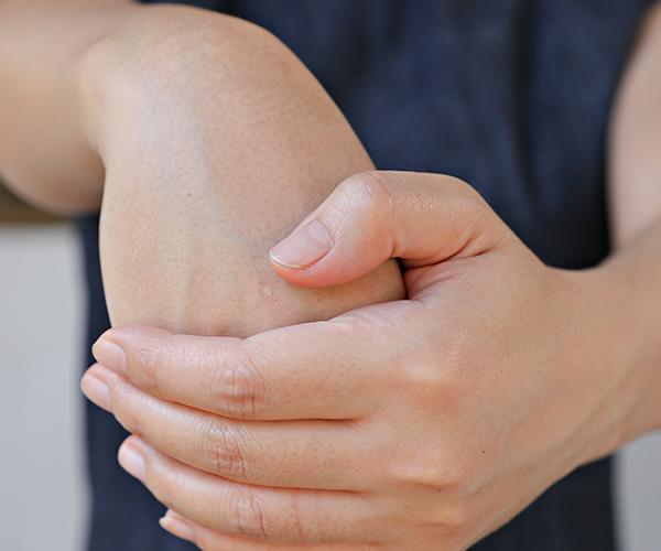 Woman stretching her wrist