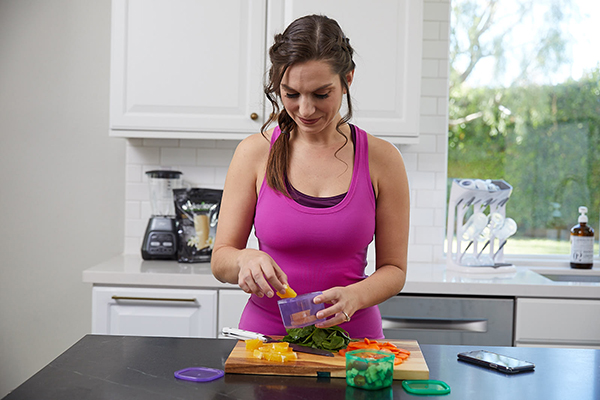 Woman using Ultimate Portion Fix containers