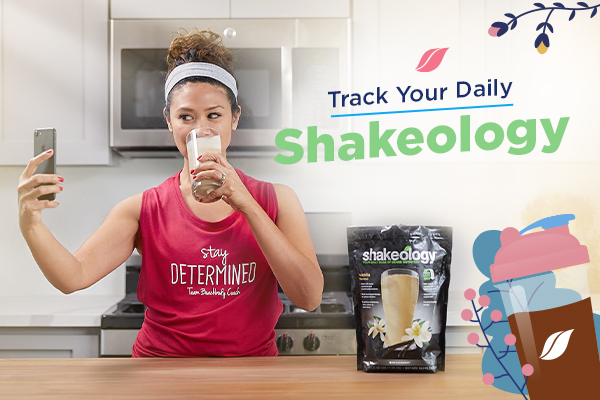 Woman taking selfie drinking Shakeology
