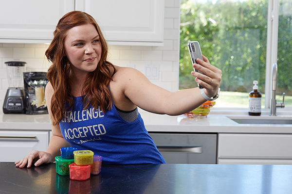 Woman taking selfie with food