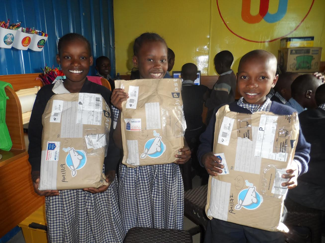 Kenyan students holding packages from Belouga