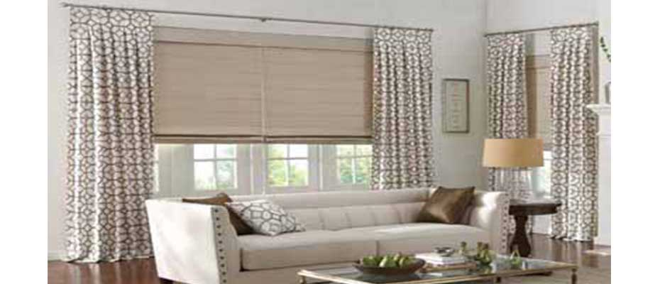A Combination Of Artisan Roman Shades And Drapes