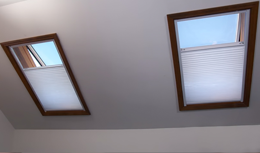 Blinds for skylights with remote control