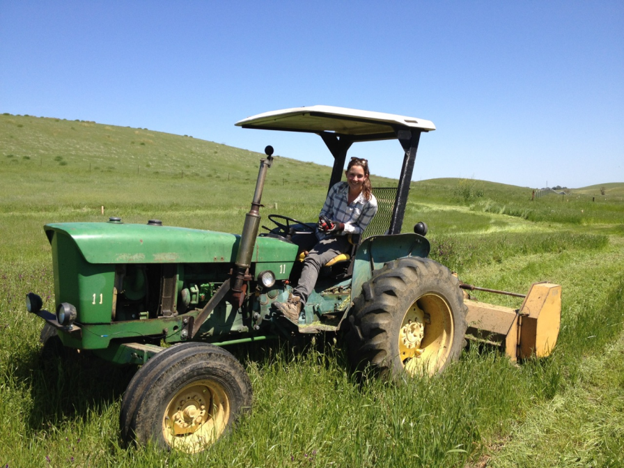 Apprentice Alex Hasbach mows pasture grass from around newly planted native species in a riparian corridor on the Rominger Brothers Farm where she is gaining experience in Farm and Ranch Management