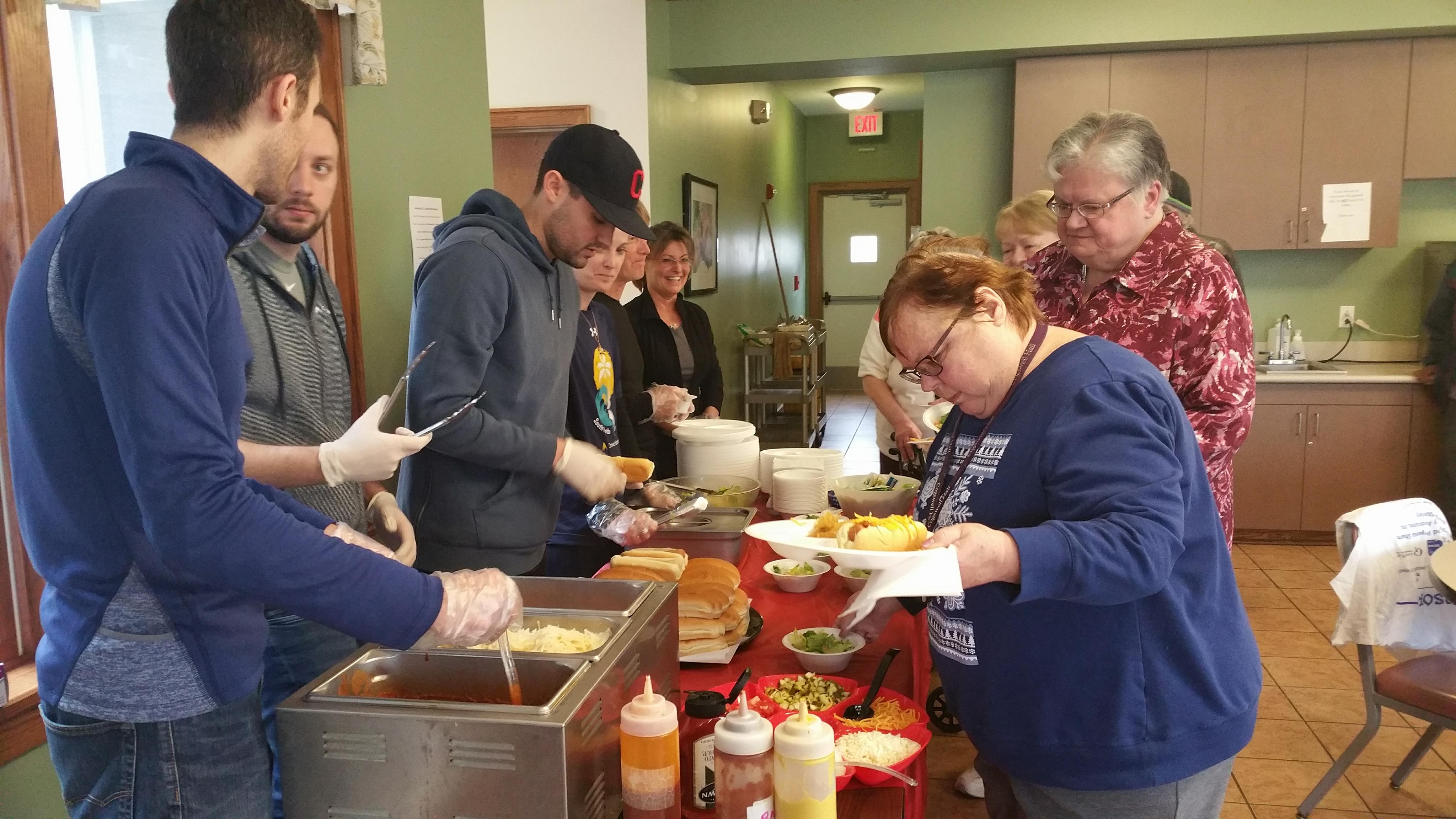 Crowe Horwath work day participants serve lunch