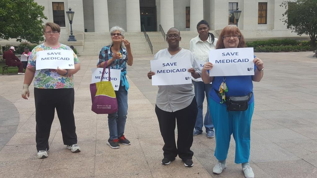 Residents at State House Medicaid rally
