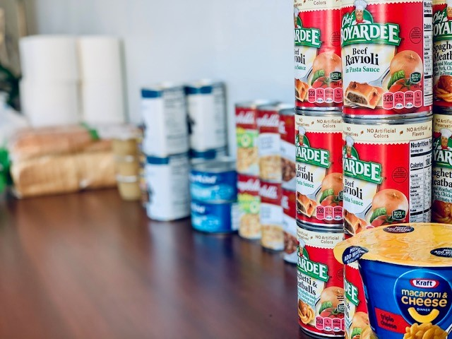 food and paper items from food pantry setup for staff at Lighthouse Works