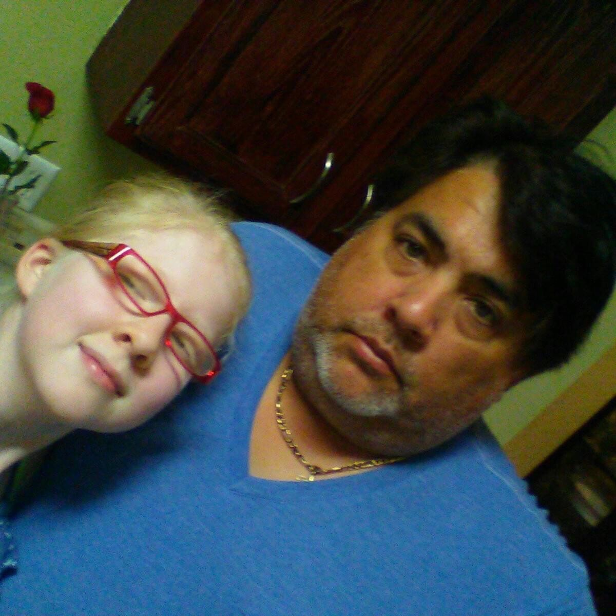 a photo of Lighthouse Transition student, Jessenia, with her father, Robert, in the kitchen