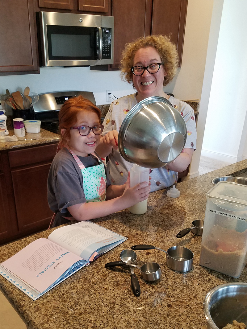 Lighthouse Children's Program  student, Libby Lufkin seen here baking cookies with her mom