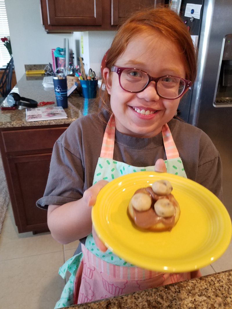 Lighthouse Children's Program student, Libby Lufkin, shows off cookie she baked