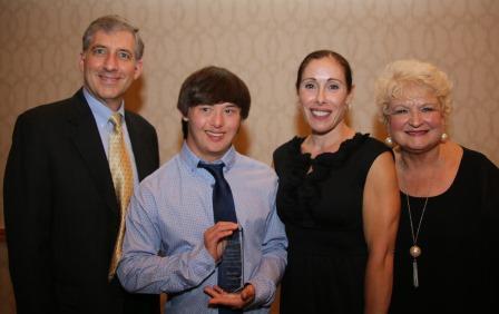 Brandon Gruber Accepts Award