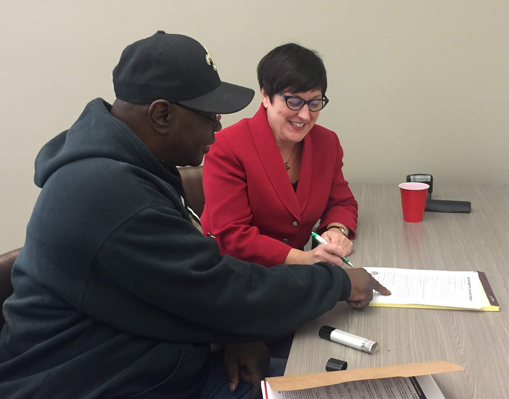 Rebecca Schiller, Volunteer Attorney, helping out a veteran in need