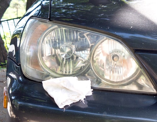 use baby oil to clean headlights