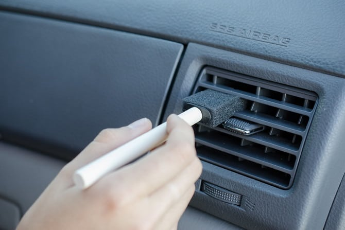 use foam brush to clean vents