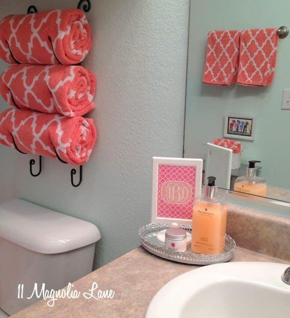 wine rack towel holder, small bathroom storage idea