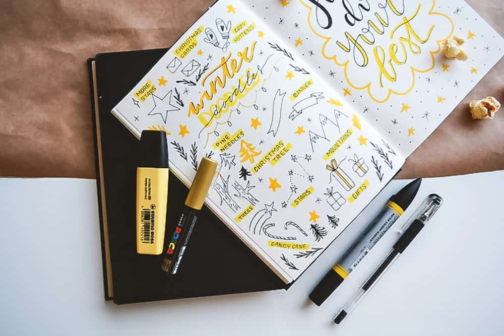 bullet journal with pens and highlighter