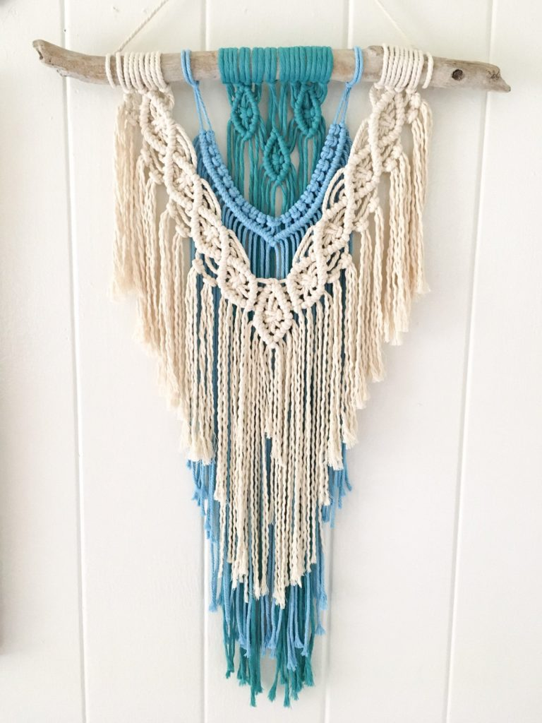 Macrame wall hanging with blue and green for the beach feel.