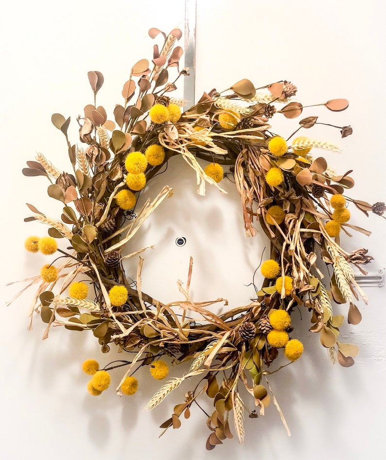 Yellow fall wreath with boho vibes.