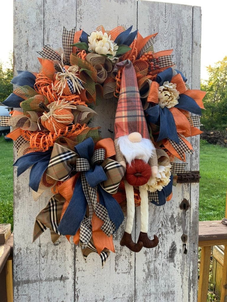 Front door wreath for fall with orange, blue and a gnome!