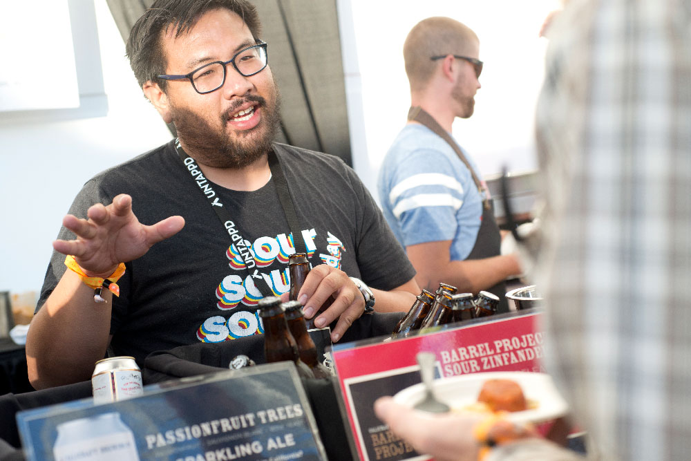 PAIRED brewer speaks with attendee
