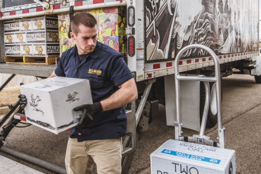 man unloads craft beer from truck