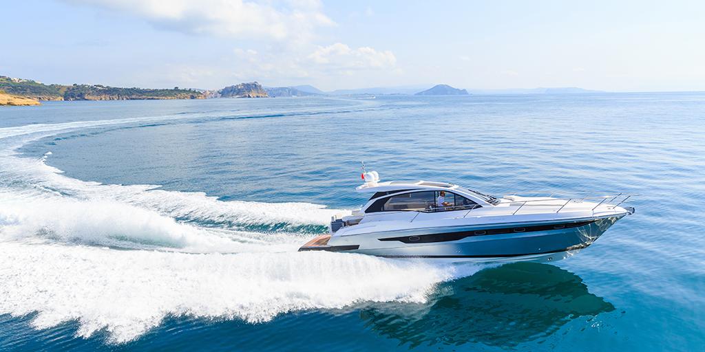A speedboat driving through the ocean.