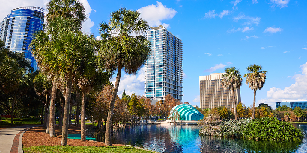 Lake Eola in Orlando, Florida during the daytime with surrounding buildings