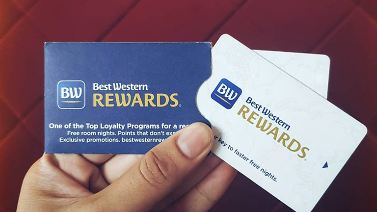 Person holding Best Western Rewards membership card.