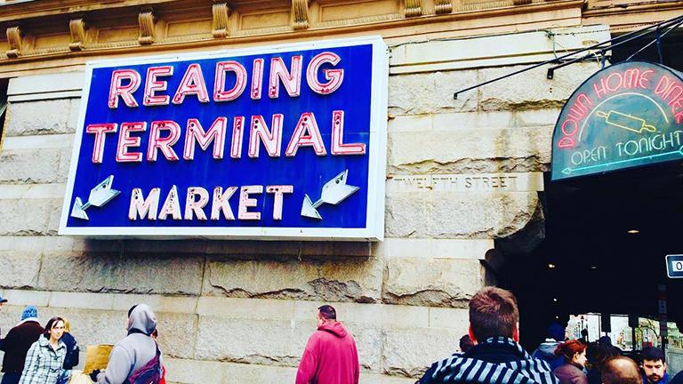 Blue neon Reading Terminal Market sign in Philadelphia, Pennsylvania.