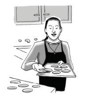 Ms. B baking cookies.