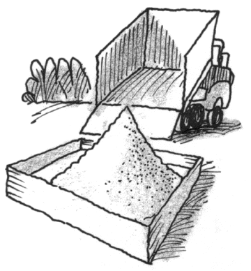 Sand being poured into a sandbox