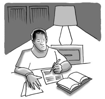 man sitting writing on paper