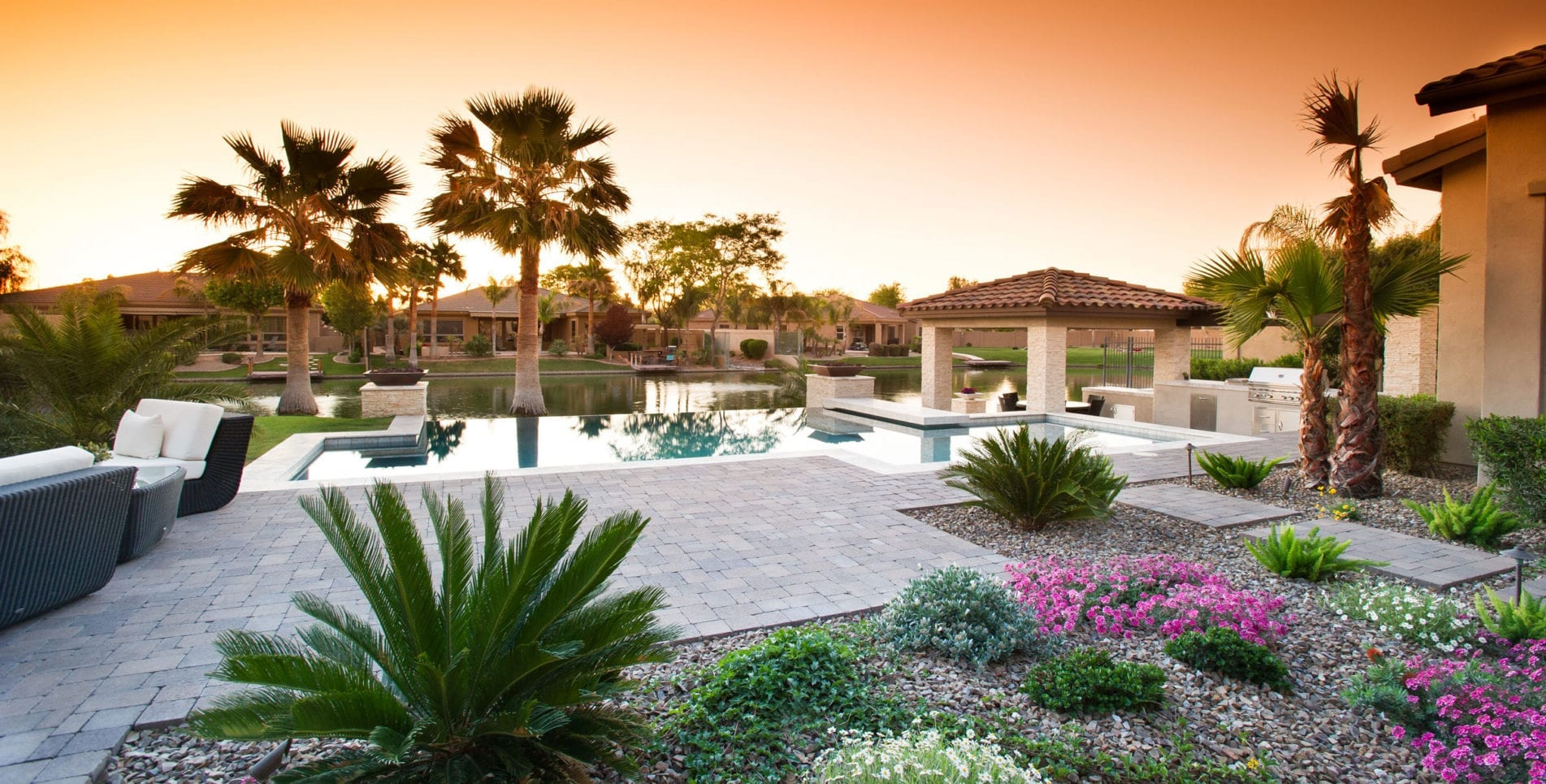 custom phoenix back yard with swimming pool next to lake