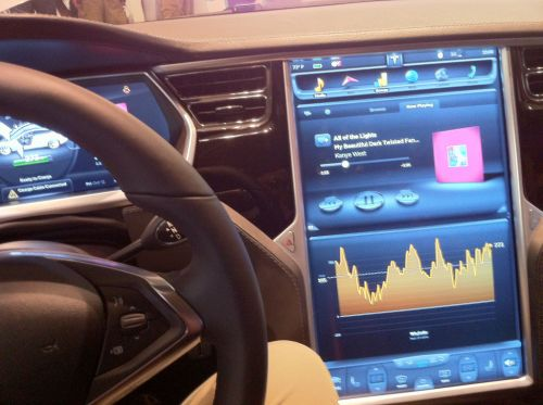 Photo of interior of Tesla computer console on the car dashboard.