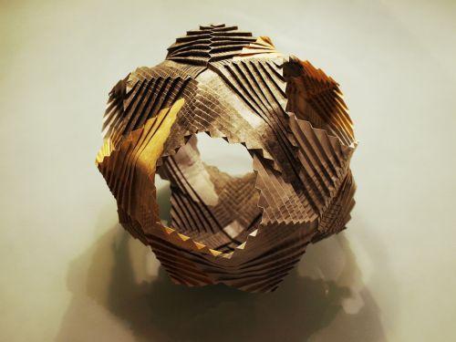 Elaborately folded paper origami ball.