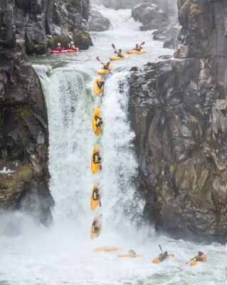 Action sequence showing a kayak going over a waterfall. The photo includes eight or so frames superimposed.