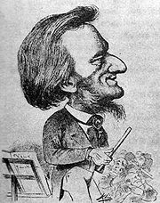 A cartoon figure holding a baton, stands next to a music stand in front of some musicians. The figure has a large nose and prominent forehead. His sideburns turn into a wispy beard under his chin.