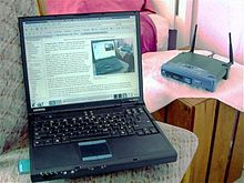 Photo of a laptop and wireless router.