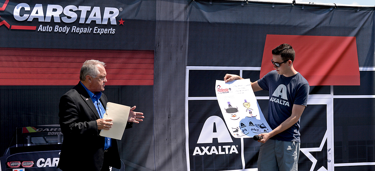 PRN President Doug Rice and NASCAR driver Alex Bowman showing one of the first submissions for the helmet design contest