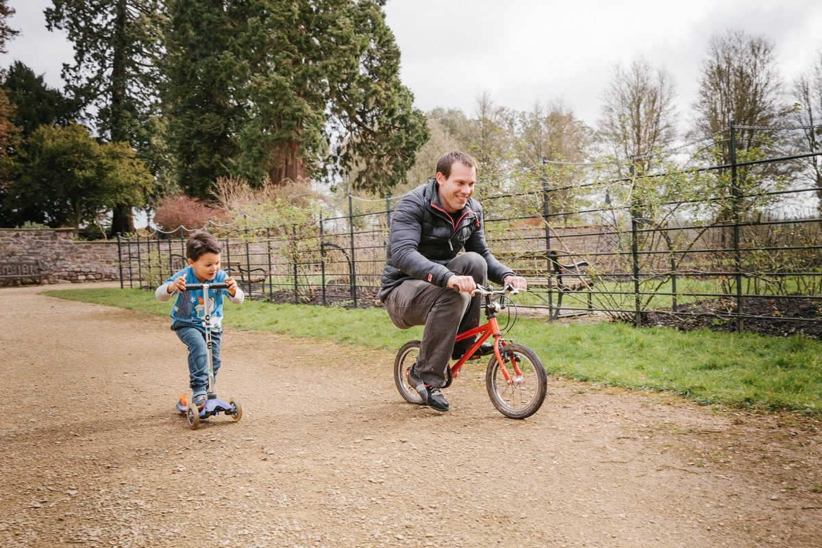 Family Photographer_Bristol Ashton Court Estate_dad and boy cycling